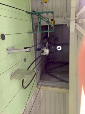 looking-up-at-a-helmet-testing-rig
